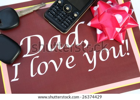 Brown greeting card for father with mobile phone, car key and ribbon - stock photo