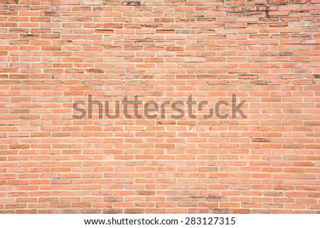 Brown grunge brick wall texture or pattern for background - stock photo
