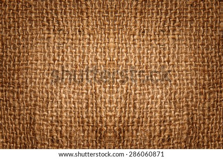 Brown grunge canvas burlap texture background with vignette  - stock photo