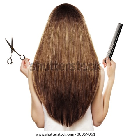 brown hair and hairdresser's tools - stock photo