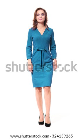 brown hair fashion model in turquoise dress isolated on white