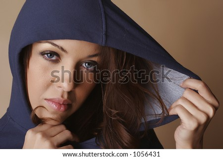 Brown hair female covered by blue hood