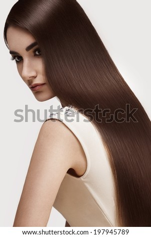 Brown Hair. Portrait of Beautiful Woman with Long Hair. High quality image. - stock photo