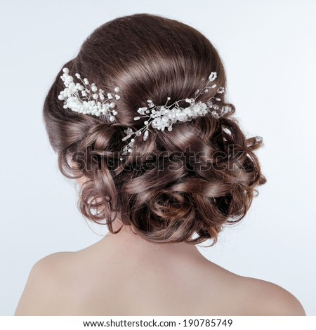Brown hair styling. Brunette girl with curly hairstyle with barrette. Bride photo  - stock photo