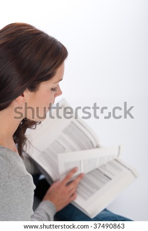 Brown hair woman reading book on white background