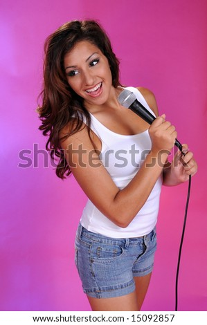 Brown haired beauty with a microphone