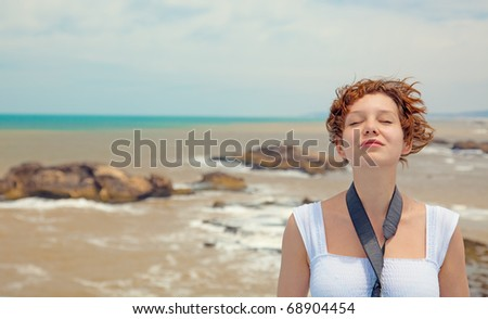 brown-haired young woman, over beautiful sea landscape photo - stock photo