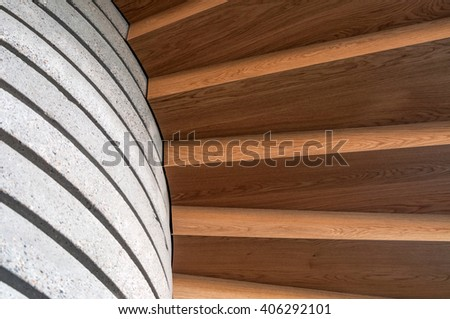 Brown hard wood stairs, and a concrete wall - stock photo