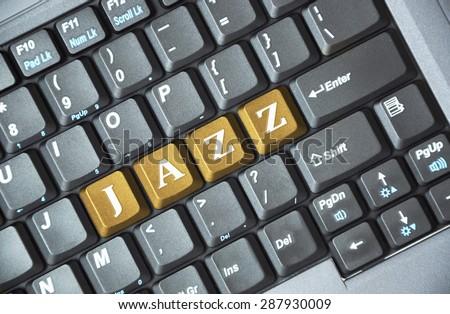 Brown jazz key on keyboard - stock photo