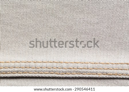 brown jeans background with seams - stock photo