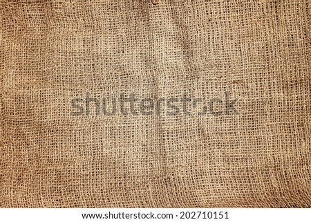 Brown jute sackcloth with subtle light.Natural texture background - stock photo