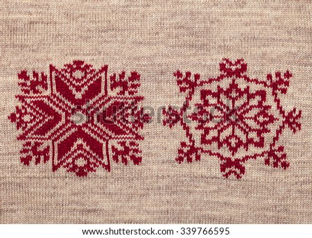 Brown knitted fabric with red christmas ornament - stock photo