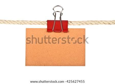 Brown label on a rope isolated on white background, closeup - stock photo