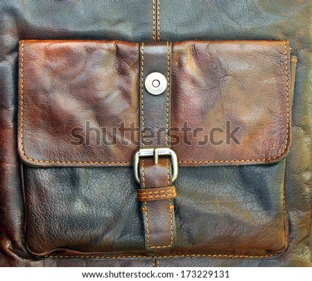 Brown leather background with a pocket attached - stock photo