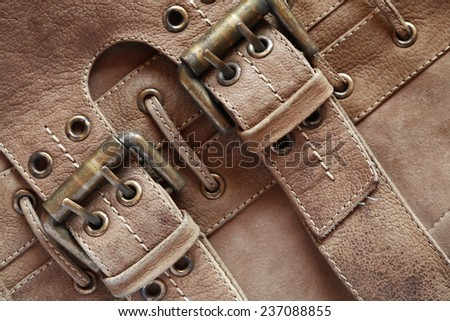 Brown leather background with belts and clasps - stock photo