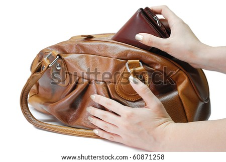 Brown leather bag  with hands and purse - stock photo