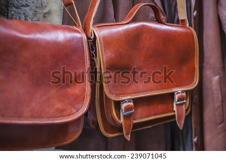 brown leather bags in the market - stock photo