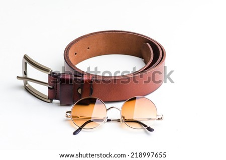 Brown leather belt for men and vintage glasses isolated on white - stock photo