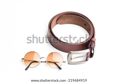 Brown leather belt for men with vintage glasses on white background. close up of office man accessories - stock photo