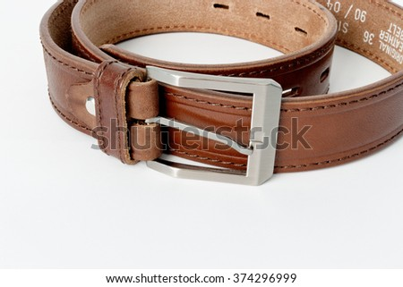 Brown leather belt isolated on white background