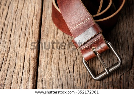 brown leather belt with metal buckle - stock photo