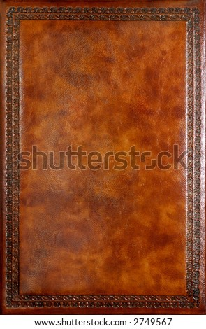 Brown leather book cover with decorative pattern - stock photo