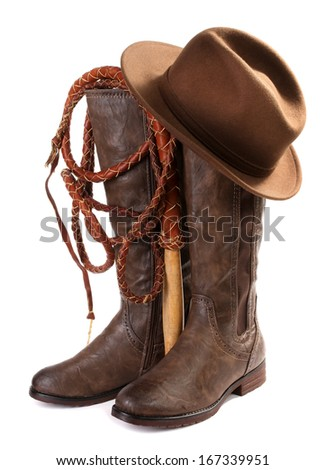 Brown leather boots, hat and whip - stock photo