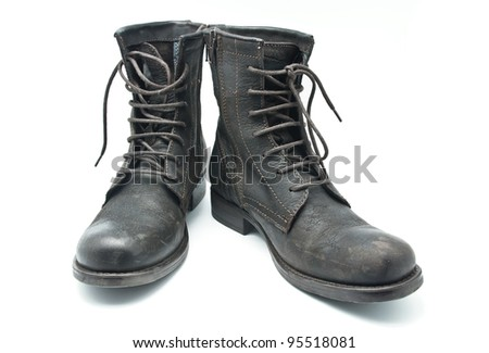 Brown leather boots on a white background