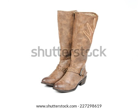 Brown leather boots with design. Seen from the front at an angle