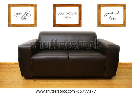 brown leather couch and blank photo frames on the wall - stock photo