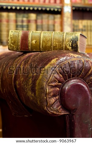 Brown leather couch with book on it - stock photo