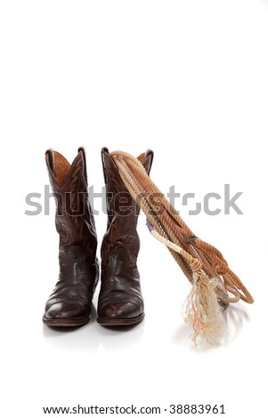 Brown leather cowboy boots and roping lariat on a white background - stock photo
