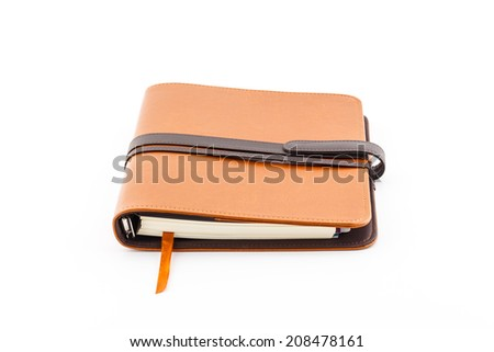 Brown leather diary book isolated on white background.