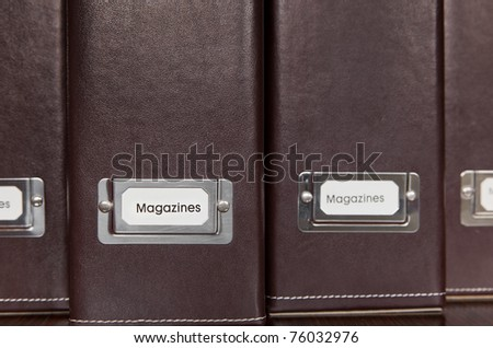 Brown leather magazine holders - stock photo