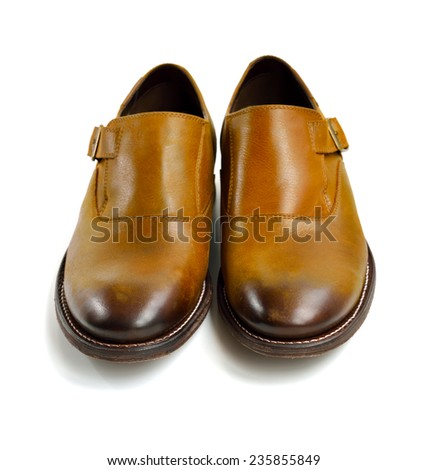 Brown leather man shoes isolated on white background, selective focus.