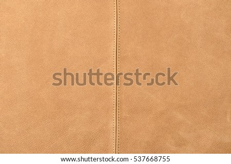 brown leather material background with sewing stitches