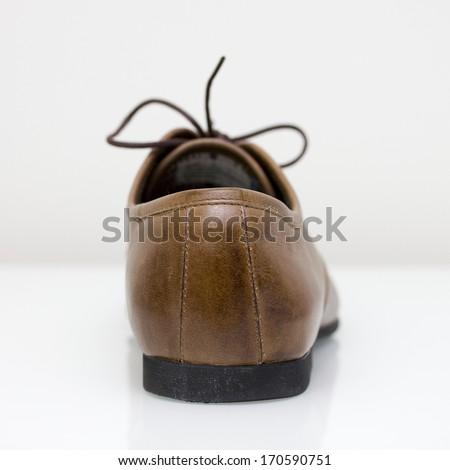 brown leather oxford shoes heel - stock photo