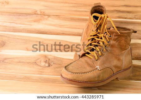 Brown leather shoes on wood background - stock photo