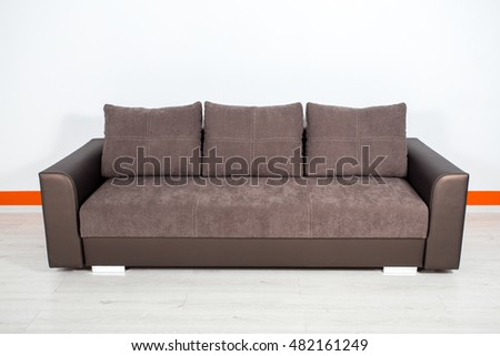 brown leather sofa on a white background