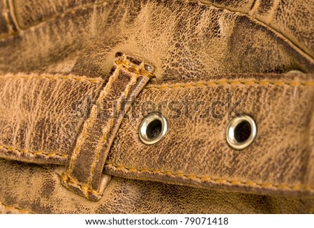 Brown leather strap closeup showing detail and texture - stock photo