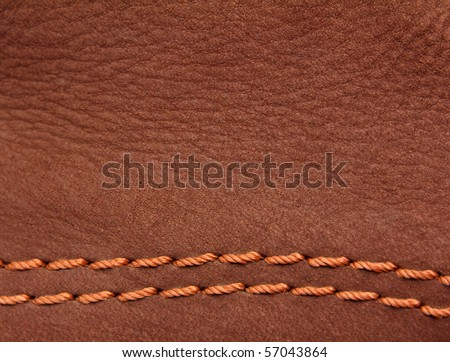 brown leather suede with sewn seams background - stock photo