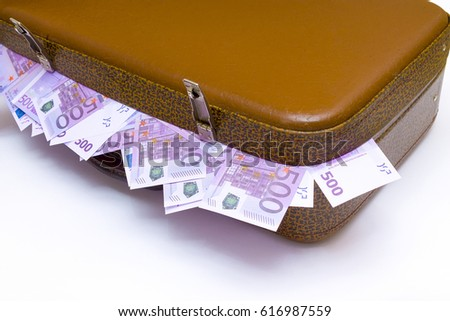 Brown leather suitcase with metal snaps with money bills on white background