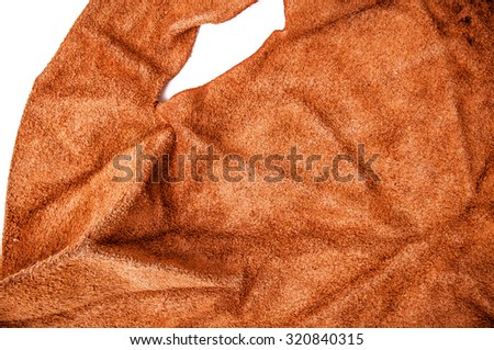 Brown Leather, Tan, Suede, Genuine. Concept and Idea of Fine Leather Crafting, Handcrafts, Handmade, Handcrafted, Leather Industry. Background Textured and Wallpaper. Rustic Style. - stock photo