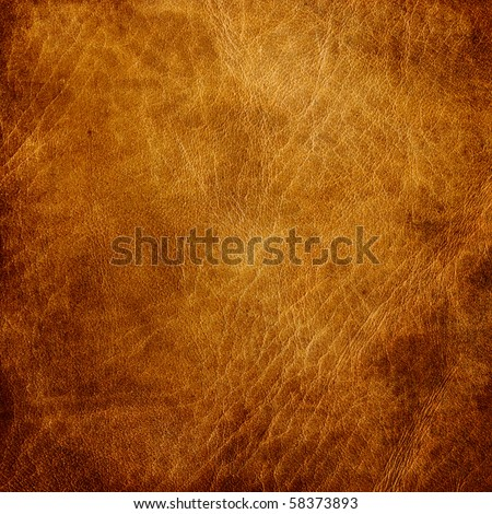 Brown leather texture closeup. Useful as background for design-works. - stock photo