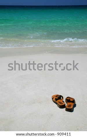 Brown Leather Thongs on a Beach - stock photo