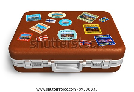 Brown leather travel suitcase with colorful labels isolated on white background - stock photo