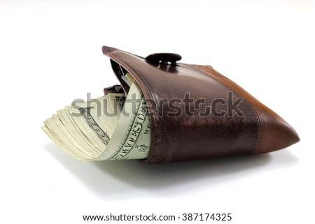 Brown leather wallet  full of dollars with white background - stock photo