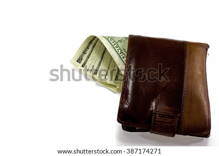 Brown leather wallet full of money on white background - stock photo