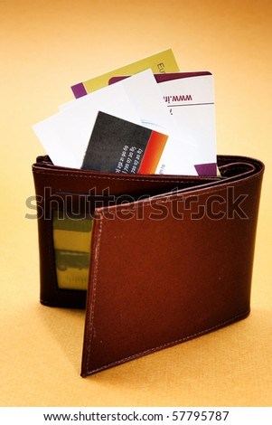 Brown leather wallet isolated on yellow - stock photo