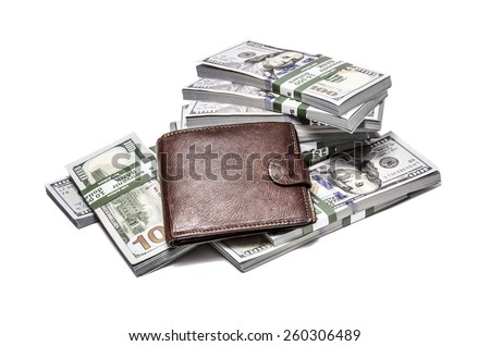 Brown leather wallet on stacks of the United States dollar - isolated on white background - stock photo
